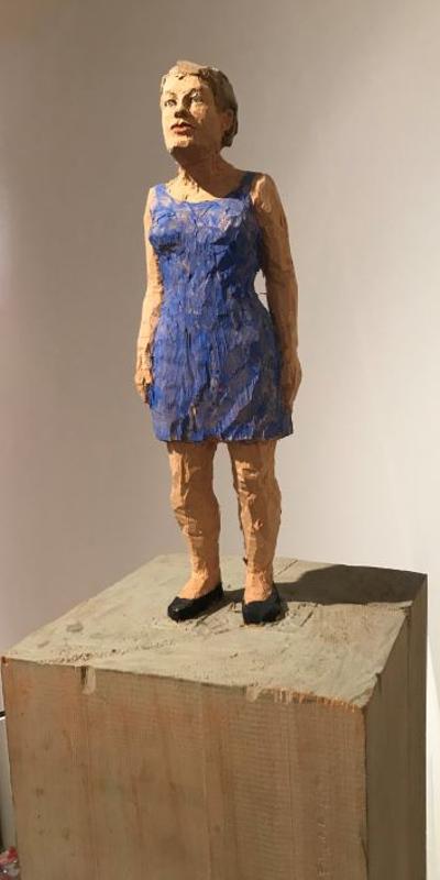 woman in blue dress by Stephan Balkenhol